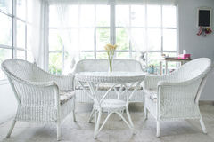 White chair and table and window sill in background Stock Images