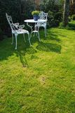 White chairs. In a private garden Stock Image