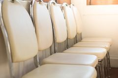 White chairs arranged in a seminar room royalty free stock photos