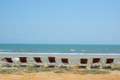 Chairs. White chairs on the beach, the sea and the mountains Royalty Free Stock Images