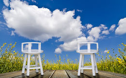 White chairs and blue sky Royalty Free Stock Images