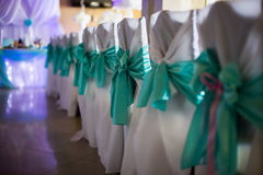 White chairs decorated for wedding, wedding ceremony, restaurant Royalty Free Stock Photo