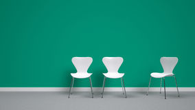 White chairs on emerald green background Royalty Free Stock Photography