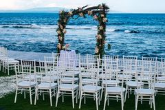 White chairs for a Bali Wedding royalty free stock photo