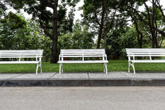 White chairs in the garden. Stock Photography
