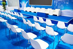 White chairs of blue business hall stock images