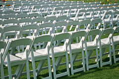 White chairs in the park waiting for event Royalty Free Stock Image