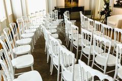White chairs in a row Stock Images