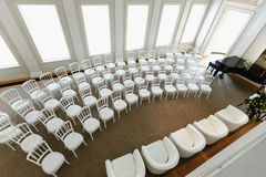 White chairs in a row Royalty Free Stock Photo