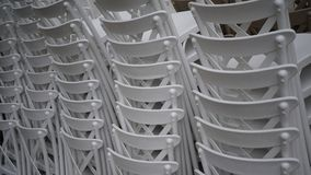 Stacked white chairs. White chairs stacked in detail Royalty Free Stock Images