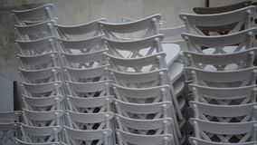 Stacked white chairs. White chairs stacked in detail Royalty Free Stock Photo