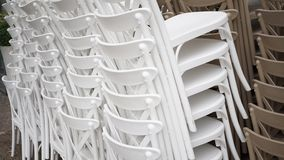 Stacked white chairs Stock Photography