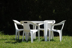White chairs and table in lawn Royalty Free Stock Photography