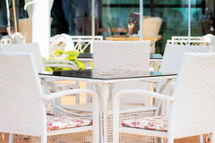White Chairs And Table In Restaurant Royalty Free Stock Photography
