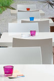 White chairs and tables. With colorful details made of glass stock images