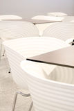 White chairs with tables. In a bar Royalty Free Stock Photo
