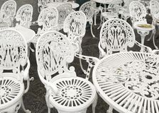 White chairs and tables outdoor Stock Photo