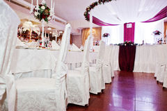 White chairs and tables of wedding quests.  royalty free stock images