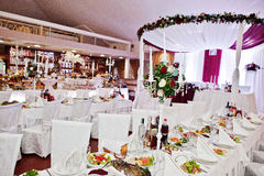 White chairs and tables of wedding quests.  stock image