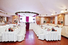 White chairs and tables of wedding quests.  royalty free stock image