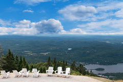 White chairs on top of mountain at a ski resort Stock Photos