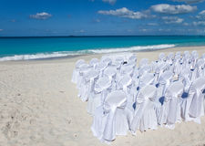 White chairs on a tropical beach Stock Photo