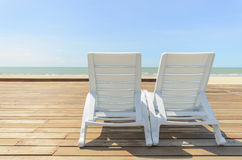 White chaise longue near the sea on the sunny day Royalty Free Stock Photos
