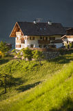 White chalet in Tyrol region of Italy Stock Photos