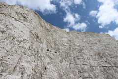 White chalk cliff and blue sky Stock Photos