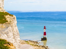 White chalk cliffs and Beachy Head Lighthouse Royalty Free Stock Images