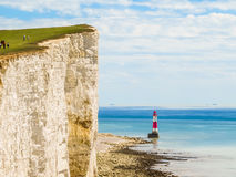 White chalk cliffs and Beachy Head Lighthouse Royalty Free Stock Photos