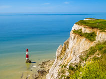 White chalk cliffs and Beachy Head Lighthouse, Eastbourne, East Sussex, England Royalty Free Stock Photos