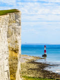 White chalk cliffs and Beachy Head Lighthouse, Eastbourne, East Sussex, England Royalty Free Stock Images