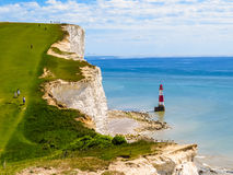 White chalk cliffs and Beachy Head Lighthouse, Eastbourne, East Sussex, England Stock Images