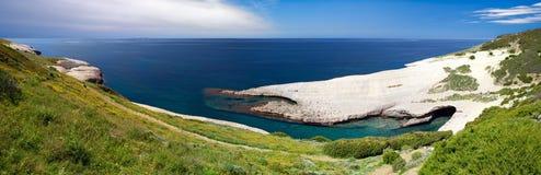 White chalk cliffs erosion coastline. Blue sky and sea at Caterina di Pittinuri Sardinia Italy panorama landscape Stock Images