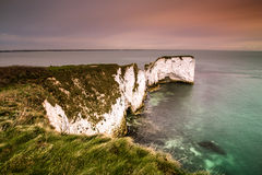 White chalk cliffs ranging into sea Stock Photo
