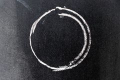 White chalk drawing in circle shape on black board. Background stock images