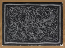 White chalk scribble on blackboard. Child art - white chalk chaotic scribble abstract on blackboard stock photography
