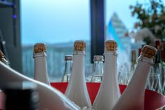 White champagne bottles in an ice cooler stock photo