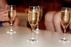White champagne glasses Stock Photos