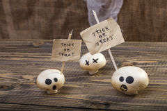 White champignons with Halloween sticks Royalty Free Stock Image