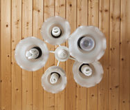 White chandelier with eco bulb Royalty Free Stock Photography