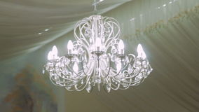 White Chandelier in The Restaurant on a Holiday Wedding stock footage