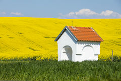 White chapel in colored fields Royalty Free Stock Image