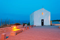 White chapel at dusk. Small white church at dusk Stock Photography