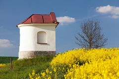 Chapel and field of rapeseed, springtime landscape Royalty Free Stock Photos