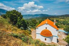 White chapel and mountains, Crete Island, Greece Stock Photos