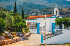 White chapel and mountains, Crete Island, Greece Stock Images