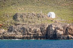 White chapel by the sea near the village of Hora Skafion in Crete Greece. White chapel by the sea near the village of Hora Skafion in Crete, Greece Royalty Free Stock Photography