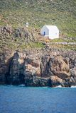 White chapel by the sea near the village of Hora Skafion in Crete Greece. White chapel by the sea near the village of Hora Skafion in Crete, Greece Stock Photography